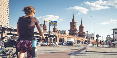 a cyclist in front of the Oberbaumbrücke in Berlin