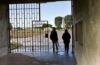 Entry Sachsenhausen Memorial Site with two people