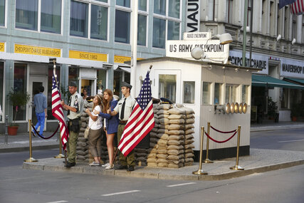 tourists taking pictures at Checkpoint Charlie in Berlin