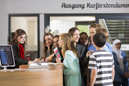 Kids on a school trip in Berlin getting information at the reception
