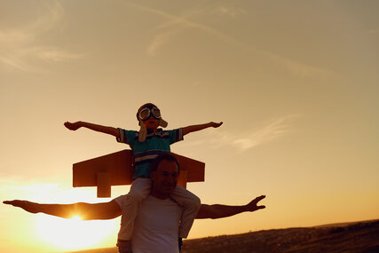 Father and son  at sunset in natur