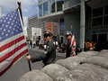"""Soldiers"" with a flag at Checkpoint Charlie"