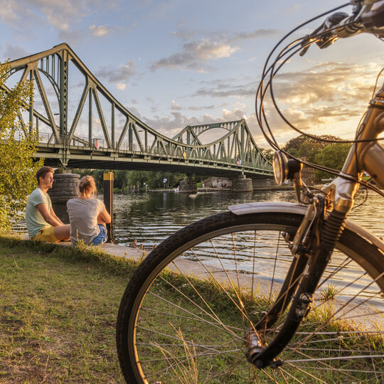 Riding by bike at Glienicker Brücke