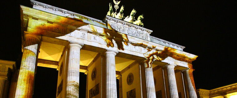 Golden illuminated Brandenburger Gate at Festival of Lights