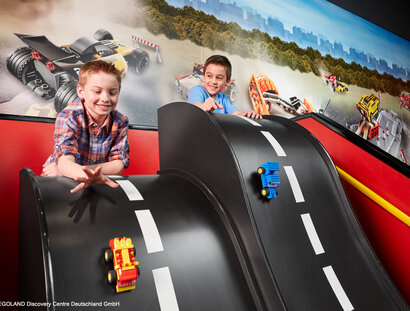 LEGOLAND Discovery Center - Two boys blaying with small Match Cars