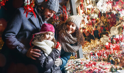 Family visiting a Berlin Christmas market