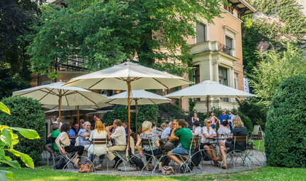Terrace of Café Wintergarten at Literaturhaus Berlin in summer time
