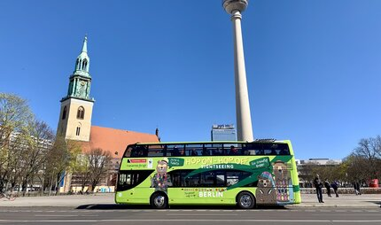 Stromma Berlin hop on hop off bus tours berlin in front of the tv tower